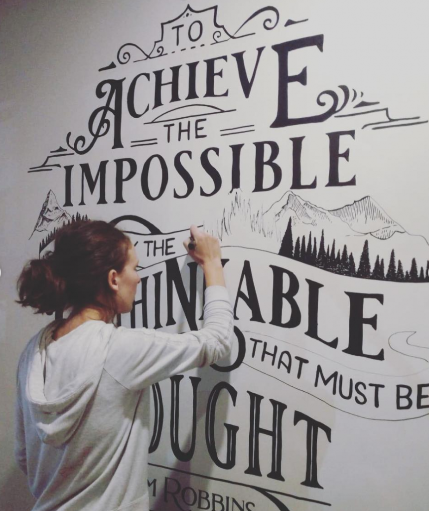 Jen painting a mural